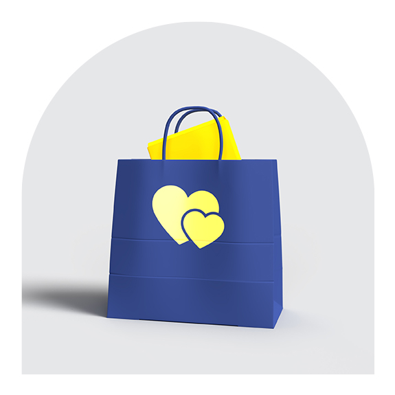 blue bag with yellow hearts and yellow envelope partially sticking out